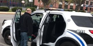 cleaning and disinfecting police vehicle