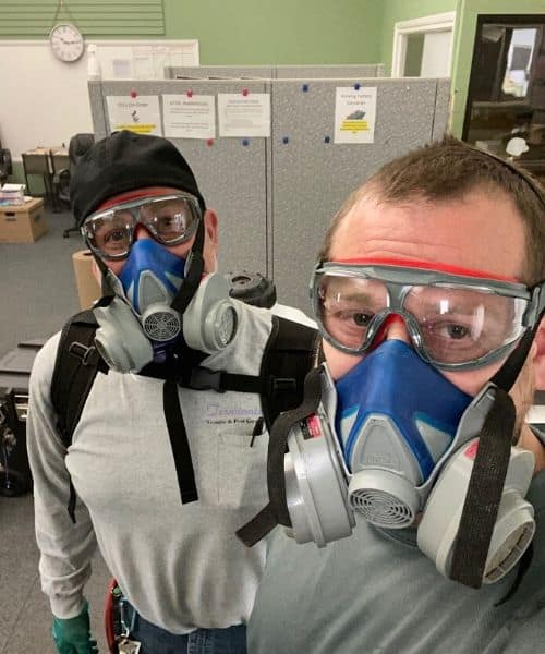 disinfecting technicians with masks on