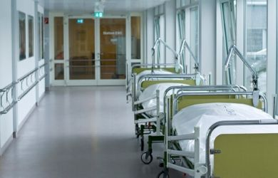 hospital hallway with several beds against the wall